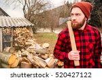 serious lumberjack holding axe... | Shutterstock . vector #520427122