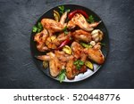 grilled chicken wings on a... | Shutterstock . vector #520448776