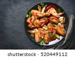 grilled chicken wings on a... | Shutterstock . vector #520449112