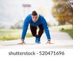 young runner in park on asphalt ... | Shutterstock . vector #520471696