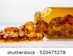 healthy fish oil capsules in... | Shutterstock . vector #520475278