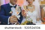 wedding glasses in hands of the ... | Shutterstock . vector #520526536