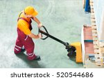 worker with fork pallet truck | Shutterstock . vector #520544686