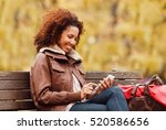 beautiful young woman in park.  | Shutterstock . vector #520586656