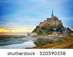 mont st michel city at sunset ... | Shutterstock . vector #520590358