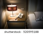 phone and lamps on side table...   Shutterstock . vector #520595188