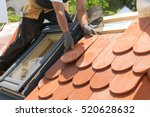 hands of roofer laying tile on... | Shutterstock . vector #520628632