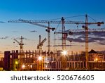 silhouettes of tower cranes... | Shutterstock . vector #520676605