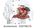 chef hands with vegetables. | Shutterstock . vector #520748176