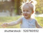 the girl in the summer park | Shutterstock . vector #520783552