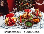 christmas dinner by candlelight ... | Shutterstock . vector #520800256