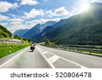 Motorcyclists in the Alps - stock photo