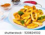 fried squid rings in... | Shutterstock . vector #520824532