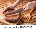 hand holding knife and cutting... | Shutterstock . vector #520830322