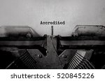 Small photo of Accredited typed words on a vintage typewriter