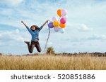 woman in blue shirt jumping... | Shutterstock . vector #520851886