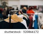 hanger with new clothes in a... | Shutterstock . vector #520866172