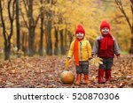 Kids In Autumn Park With...