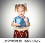 little funny girl in striped... | Shutterstock . vector #520874692