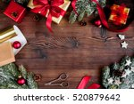 gifts boxes with fir branches... | Shutterstock . vector #520879642