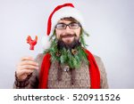 guy dressed as santa wearing... | Shutterstock . vector #520911526