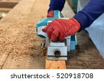 close up hands of carpenter... | Shutterstock . vector #520918708
