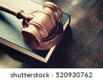 judge gavel and legal book on... | Shutterstock . vector #520930762