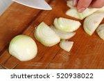 chef slicing onion. making...