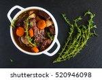 beef bourguignon in a white... | Shutterstock . vector #520946098