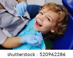 smiling child sitting in a blue ... | Shutterstock . vector #520962286