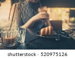croissant and glass of iced... | Shutterstock . vector #520975126