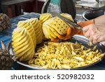 fruit seller is peeling the... | Shutterstock . vector #520982032