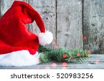 santa claus hat and xmas tree... | Shutterstock . vector #520983256