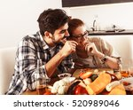 young couple in kitchen... | Shutterstock . vector #520989046