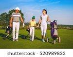 Family Golfers Walking On Golf...