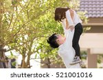 father carrying daughter up... | Shutterstock . vector #521001016