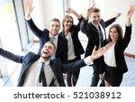 happy business team celebrating ... | Shutterstock . vector #521038912