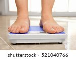 legs of a young woman measuring ... | Shutterstock . vector #521040766