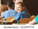 cute schoolgirl on lesson in... | Shutterstock . vector #521052772