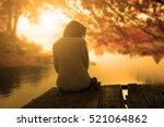 relaxing woman in sunset | Shutterstock . vector #521064862