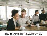 happy couple enjoying a coffee... | Shutterstock . vector #521080432