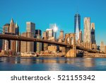 Stock photo famous skyline of downtown new york brooklin bridge and manhattan at the early morning sun light 521155342