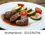meat medallion drizzled with...   Shutterstock . vector #521156746