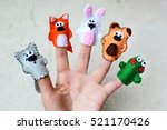 Hand Wearing 5 Finger Puppets ...
