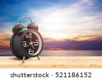 vintage alarm clock on wooden... | Shutterstock . vector #521186152