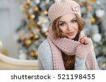 beautiful woman in warm... | Shutterstock . vector #521198455