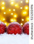 red christmas balls in the snow | Shutterstock . vector #521202496