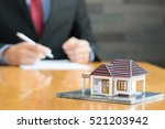 businessman signing a contract... | Shutterstock . vector #521203942