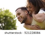 close up of young adult couple... | Shutterstock . vector #521228086