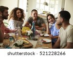 young adult friends at a table... | Shutterstock . vector #521228266